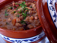 Detail of the bean stew of octopus and cuttlefish, at Taberna do Gabao, which is one of the most famous restaurants at Odeceixe. Odeceixe, Algarve is a small village near the coast, with a small river, Ceixe, that marks the border between Algarve and Alentejo.