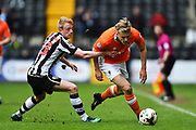 Blackpool midfielder Brad Potts (8) battles with Notts County defender, on loan from Hull City, Josh Clackstone (23) during the EFL Sky Bet League 2 match between Notts County and Blackpool at Meadow Lane, Nottingham, England on 29 April 2017. Photo by Jon Hobley.