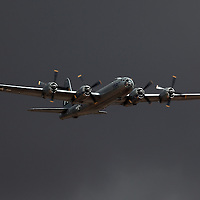 "B29 Super Fortress ""FiFi"" at California Capital Airshow in Sacramento. Ominous storm clouds in background with sun lighting this wonderful old bomber."