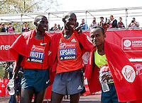 London marathon winner Wilson Kipsang (C), 2nd placed Stanley Biwatt (L) and 3rd placed Tsegaye Kebede of Ethiopia<br /> The Virgin Money London Marathon 2014<br /> 13 April 2014<br /> Photo: Jed Leicester/Virgin Money London Marathon<br /> media@london-marathon.co.uk