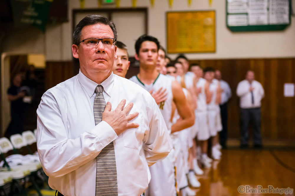 Placer Hillman head coach Mark Lee stands for the national anthem as the Placer Hillman host the Liberty Ranch Hawks Varsity basketball team in the DIV NorCal boys quarterfinal, Saturday Mar 10, 2018.  <br /> photo by Brian Baer
