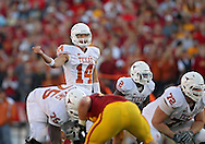October 01, 2011: Texas Longhorns quarterback David Ash (14) motions to a receiver during the first half of the game between the Iowa State Cyclones and the Texas Longhorns at Jack Trice Stadium in Ames, Iowa on Saturday, October 1, 2011. Texas defeated Iowa State 37-14.