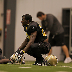 10 August 2009: New Orleans Saints cornerback Malcolm Jenkins (27) stretches on the field during New Orleans Saints training camp at the team's indoor practice facility in Metairie, Louisiana.