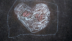 September 21, 2016 - heart drawn with chalk on asphalt (Credit Image: © Igor Goiovniov/ZUMA Wire)