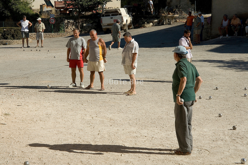 Boules players in a village square in France Provence