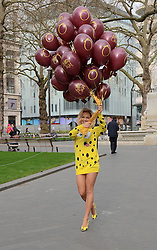 Rita Ora releases balloons, wearing a Spongebob Squarepants outfit, to celebrate the release of her latest single 'I Will Never Let You Down' in Leicester Square, London on Monday 31March 2014