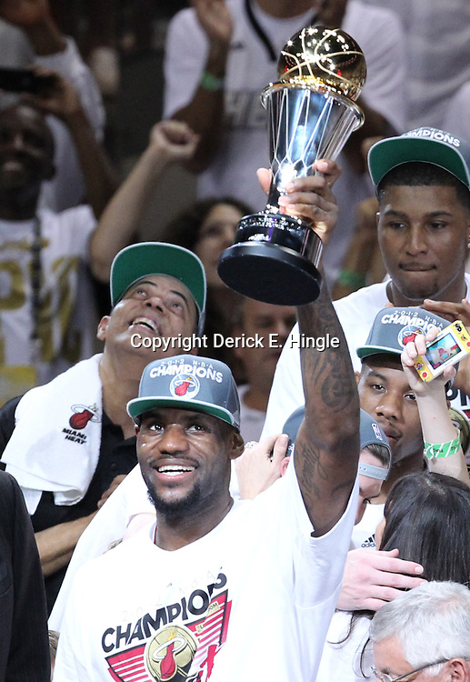 Jun 21, 2012; Miami, FL, USA; Miami Heat small forward LeBron James celebrates with the MVP trophy after winning the 2012 NBA championship at the American Airlines Arena. Miami won 121-106. Mandatory Credit: Derick E. Hingle-US PRESSWIRE