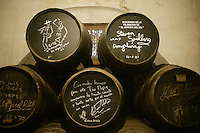 ca. 2003, Jerez de la Frontera, Spain --- Wine casks in the cellar of the Gonzalez Byass winery in Jerez de la Frontera are signed by various famous customers, including Steven Spielberg (upper right). --- Image by © Owen Franken/CORBIS