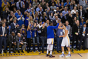 Golden State Warriors forward Kevin Durant (35) high fives Golden State Warriors guard Klay Thompson (11) as he closes out 60 points in three quarters against the Indiana Pacers at Oracle Arena in Oakland, Calif., on December 5, 2016. (Stan Olszewski/Special to S.F. Examiner)