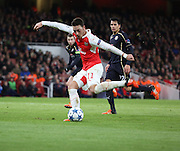Arsenal midfielder Mesut Ozil with a shot on goal during the Champions League match between Arsenal and Dinamo Zagreb at the Emirates Stadium, London, England on 24 November 2015. Photo by Matthew Redman.