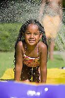 """Girl Sliding on """"Slip 'N Slide"""""""