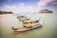Long tail boats moored along a beach in Koh Yao Noi, Thailand, Southeast Asia