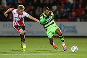 Forest Green Rovers Dan Wishart(17) runs forward under pressure from Cheltenham Town's Taylor Moore(28) during the EFL Trophy match between Cheltenham Town and Forest Green Rovers at Whaddon Road, Cheltenham, England on 3 October 2017. Photo by Shane Healey.
