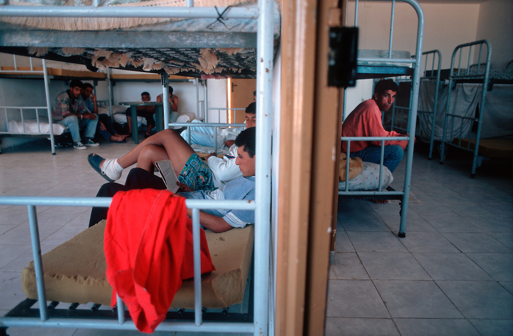 Algerian immigrants who have entered the Spanish enclave of Melilla from Morocco live in a reception center while they attempt to find a way across the Strait of Gibraltar to the European continent.<br />