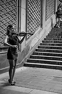 Musician with her violin at Bethesda Terrace in Central Park.