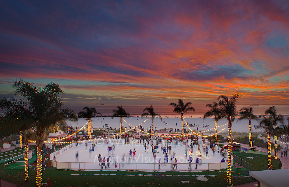 The Hotel del Coronado hosts an ice skating rink during the holidays, overlooking the beach, Pacific Ocean and a glorious sunset. Photography by Dallas event photographer William Morton of Morton Visuals.