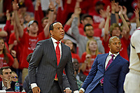 Men's basketball coach Kevin Keatts watches a three-point attempt during ACC action against UVA in PNC Arena.