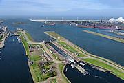 Nederland, Noord-Holland, Gemeente Velsen, 09-04-2014; Noordzeekanaal met sluizen IJmuiden. Duwbakken verlaten de Middensluis, links Zuidersluis. In de achtergrond Tata Steel (voorheen Corus, Hoogovens).<br /> Entrance Noorzee-channel with locks and Tata Steel in the background.<br /> luchtfoto (toeslag op standard tarieven);<br /> aerial photo (additional fee required);<br /> copyright foto/photo Siebe Swart