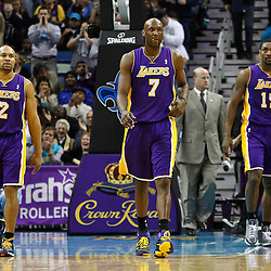 February 5, 2011; New Orleans, LA, USA; Los Angeles Lakers power forward Lamar Odom (7) and point guard Derek Fisher (2) and small forward Ron Artest (15) walk off the court at halftime of a game against the New Orleans Hornets at the New Orleans Arena.   Mandatory Credit: Derick E. Hingle