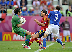 (L) Italy's goalkeeper Gianluigi Buffon (nr01) and (R) Italy's Giorgio Chiellini (nr03) fight for the ball with (C) Spain's Cesc Fabregas (nr10) during their the UEFA EURO 2012 Group C football match between Spain and Italy at Gdansk Arena in Gdansk on June 10, 2012...Poland, Gdansk, June 10, 2012..Picture also available in RAW (NEF) or TIFF format on special request...For editorial use only. Any commercial or promotional use requires permission...Photo by © Adam Nurkiewicz / Mediasport