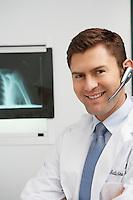 Doctor wearing earpiece in hospital,portrait