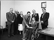 People Of The Year Awards.    (N74).1981..05.05.1981..5th May 1981..Dr Michael Woods TD,Minister for Health & Social Welfare, today presented 73 People of The Year Lapel Emblems at an official ceremony in the New Ireland Assurance Co., Ltd, Dawson Street, Dublin. The lapel emblems were created as a result of recipients of the awards seeking to promote their work by identifying with the awards. It is intended that future recipients of The People Of The Year Awards silver medallions would also receivea lapel emblem...Image shows Michael Woods TD,Minister for Health and Social Welfare,presenting awards at the ceremony. Unfortunately we do not have a caption sheet. If you know the people involved why not let us know at irishphotoarchive@gmail.com