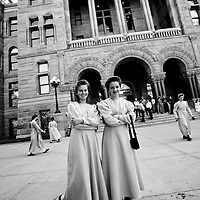 Members of the polygamist Fundamentalist Church of Jesus Christ of Latter Day Saints protest sale of their land outside the courthouse in downtown Salt Lake City
