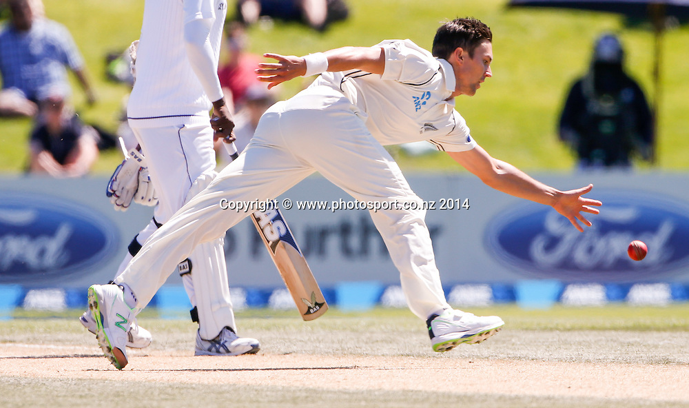 Trent Boult attempts to field off his bowling. Day 4, ANZ Boxing Day Cricket Test, New Zealand Black Caps v Sri Lanka, 29 December 2014, Hagley Oval, Christchurch, New Zealand. Photo: John Cowpland / www.photosport.co.nz