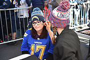 A lady has Chargers face paint applied during the International Series match between Tennessee Titans and Los Angeles Chargers at Wembley Stadium, London, England on 21 October 2018.
