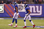 New York Giants free safety Andrew Adams (33) looks on as New York Giants outside linebacker Devon Kennard (59) leaps and celebrates after recovering a strip sack fumble by the Detroit Lions that gives the Giants the ball at their own 35 yard line in the second quarter during the 2017 NFL week 2 regular season football game against the against the Detroit Lions, Monday, Sept. 18, 2017 in East Rutherford, N.J. The Lions won the game 24-10. (©Paul Anthony Spinelli)