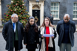 © Licensed to London News Pictures. 12/12/2017. London, UK. Bereaved families from the Grenfell Tower tragedy (L-R: Nicholas Burton, a girl who does not want to be named, Sandra Ruiz and Kareem Mussilhy) speak to media after handing a petition in at Downing Street, calling for the public inquiry into the disaster to be overhauled. This includes having a panel from a diverse range of backgrounds installed alongside Sir Martin Moore-Bick, the retired Court of Appeal judge leading the process. Photo credit : Tom Nicholson/LNP
