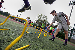 01 June 2016. New Orleans, Louisiana.<br /> Senior coaches from the New Orleans Jesters oversee their Advanced Summer Camp training for the Jesters Youth Academy and other children. The camp focuses on fitness, ball control, team work and essential soccer skills in a fun, relaxed atmosphere with plenty of water breaks and shade, ensuring the children remain hydrated and able to fully enjoy and make the most their week with the best coaches in Louisiana. <br /> Photo©; Charlie Varley/varleypix.com