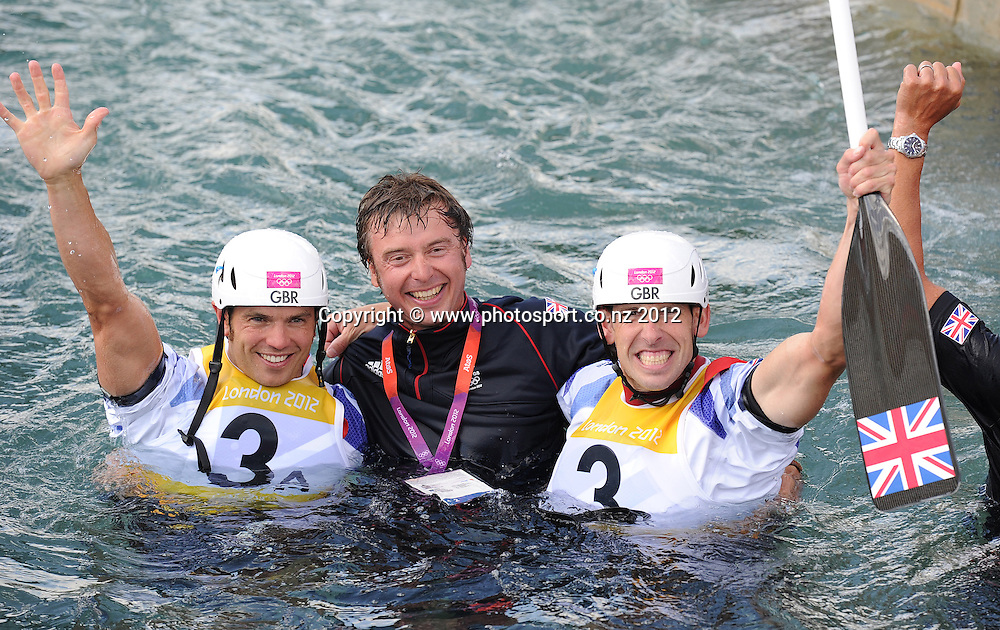 Great Britain's Gold medal winning team Tim Baillie (L) and Etienne Stott with their coach in the water at the conclusion of the Men's C2 Canoe Slalom at the Lee Valley Whitewater Centre, London, United Kingdom. Thursday 2 August 2012. Photo: Andrew Cornaga/Photosport.co.nz