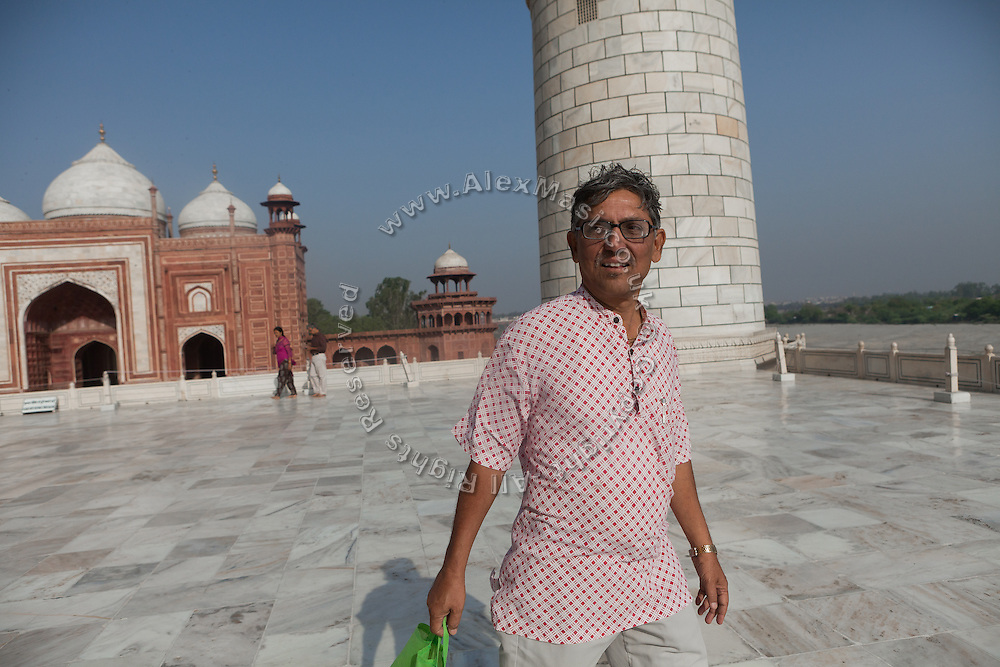Brij Khandelwal, a renown environmental journalist for the Times of India, is walking on the Markana marble floor inside the Taj Mahal complex.