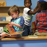 Adam Robison | BUY AT PHOTOS.DJOURNAL.COM<br /> Max Ivy, a pre-k student at ECEC, reads a book in the interactive sculpture exhibit Thursday morning in class. The reading portion of the exhibit allows children to have access to high quality print materials and a reading nook that places the books at their level.