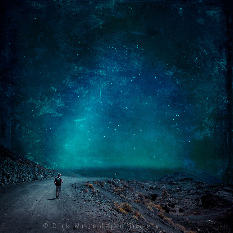 Man walking through a nightly desolate country - manipulated photograph