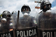Riot squads stands guard as supporters of ousted Honduran President Manuel Zelaya during a protest against the military coup at Toncontin International Airport in Tegucigalpa on July 5, 2009.