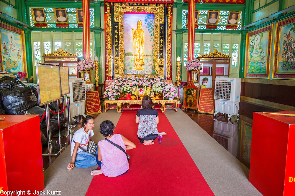 05 OCTOBER 2012 - BANGKOK, THAILAND:   People pray at the Kuan Yim Shrine in the Chinatown section of Bangkok, Thailand. The Kuan Yim Shrine is administered by the  Than Fah Foundation, first organized by Chinese immigrants to Thailand in the 1800's.    PHOTO BY JACK KURTZ