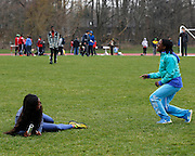 Victoria Thompson, right, and Adama Donzo, both of Rush-Henrietta, laugh after Donzo fell during warmups at the His and Her track and field invitational at Penfield High School on Saturday, April 26, 2014.