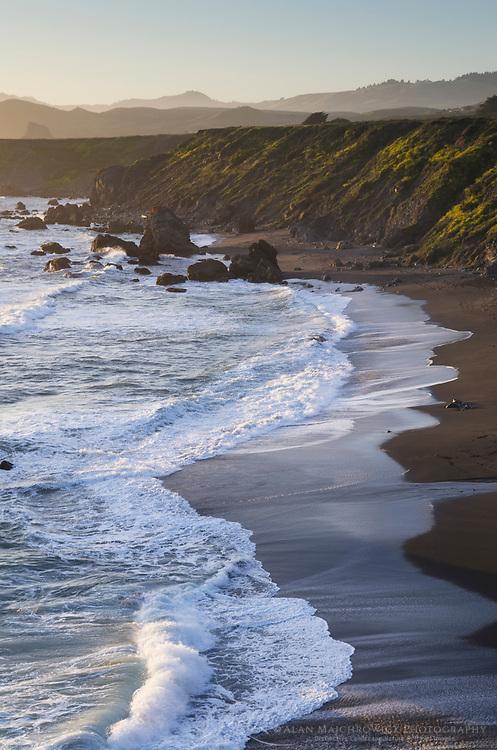 Waves crashing on  sand beach on Sonoma Coast California