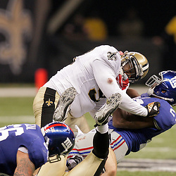2009 October 18: New Orleans Saints defensive tackle Sedrick Ellis (98) tackles New York Giants running back Brandon Jacobs (27) during a 48-27 win by the New Orleans Saints over the New York Giants at the Louisiana Superdome in New Orleans, Louisiana.