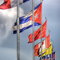 International Flags line the waterway on Sisowath Quay - Main Riverside Road in Phnom Penh, Cambodia