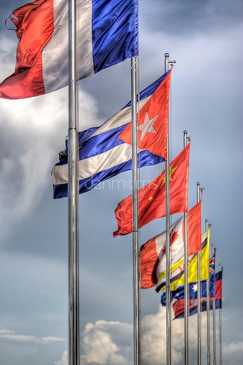 International Flags line the waterway on Sisowath Quay - Main Riverside Road in Phnom Penh, Cambodia
