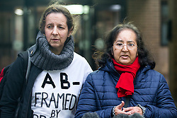 "© Licensed to London News Pictures. 29/01/2016. London, UK. JOSEPHINE HERIVEL (L) wearing a t-shirt with the words ""A B - FRAMED BY BRITISH STATE""  written on it, stands next to CHANDRA BALAKRISHNA (R), the wife of Aravindan Balakrishnan, as she speaks to media as they leave Southwark Crown Court in London where Maoist cult leader Aravindan Balakrishnan has been sentenced to 23 years in prison for rape, child cruelty and false imprisonment. Aravindan Balakrishnan was found guilty of the rape of two of his followers and and false imprisonment of  his daughter for more than 30 years in a commune in south London.  Photo credit: Peter Macdiarmid/LNP"