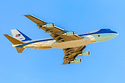 Air force One in flight with a blue sky background