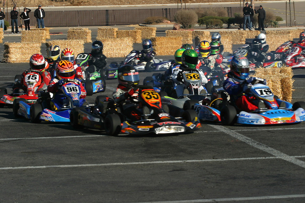 Young drivers whizz by in their go karts during the International Karting Federation race in Primm, Nevada on Saturday March 3, 2007.