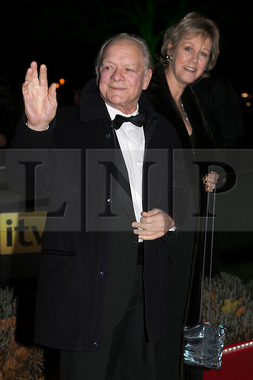© licensed to London News Pictures. London, UK 06/12/2012. Sir David Jason (left) attending The Sun Military Awards at Imperial War Museum with his wife. Photo credit: Tolga Akmen/LNP