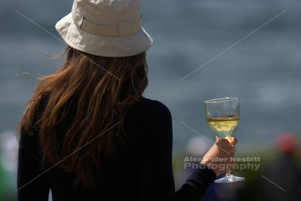 Newport, RI 2007 - Girl hold wine glass while watching Tallships from around the world congregate in Newport for the summer of 2007 Tallships festival.