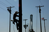 Alex Woodard of Zanesville, OH makes his way down a pole after competing in the rope splice at the 2007 Penn-Ohio Lineman's Rodeo at the Greenville Municipal Airport. Events in the competition also included pole top rescue, cross arm change, and transformer connection.