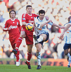 LIVERPOOL, ENGLAND - Saturday, January 30, 2010: Liverpool's captain Steven Gerrard MBE and Bolton Wanderers' Tamir Cohen during the Premiership match at Anfield. (Photo by: David Rawcliffe/Propaganda)